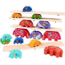 compare elephant seesaw balance beam wood blocks toys children s desktop pa child game animal stack high