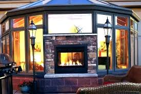 indoor outdoor wood burning fireplace stagger see thru home ideas 16