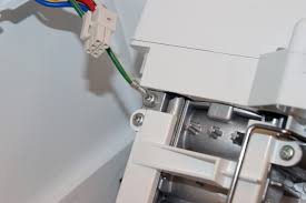 kenmore ice maker replacement. unplug the wire harness. kenmore ice maker replacement