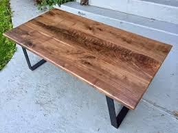 coffee table made with solid black walnut wood highly figured section featured in the center slab swirling grain and medium dark brown tones throughout