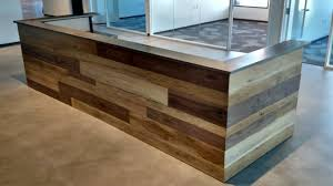 contemporary reclaimed wood and steel reception desk by daniel chase