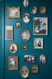 home decorating ideas vintage old pictures in vintage frames on a pretty shade of blue wall gallery idea