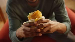 man eating subway signature wrap