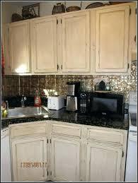 diy antiquing kitchen cabinets off white distressed kitchen cabinets distressed white kitchen cabinets diy antique cream