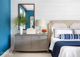 Blue And Gray Bedroom With Gray Dresser As Nightstand