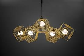 unique brass ceiling lamp in trendy gold color inspired by modern geometric design