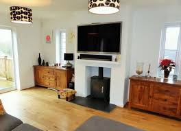 image result for installing a tv over a wood burning stove wood