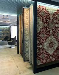 area rugs are displayed by collection and style on a pull out tracking system complementing the showroom s interior design