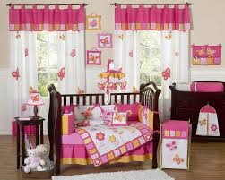 deluxe baby room design with black nursery cribs and white erfly curtain motive also laminated wooden floor idea