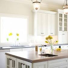 butcher block island top view full size beautiful kitchen features white cabinets paired with black countertops