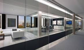 extendo is a telescoping mechanism designed to divide space through simultaneous sliding frameless glass doors providing a large opening with minimal