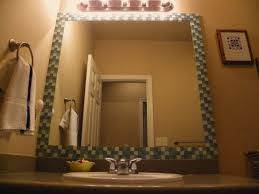 diy tile framed bathroom mirror. diy tile glass frame for plain old builder grade bathroom mirror. inexpensive\u2026only need a few sheets of the and tube adhesive! diy framed mirror .