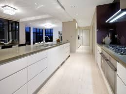 fantastic lighting. kitchen:modern galley kitchen with high gloss white cabinet and fantastic lighting design s