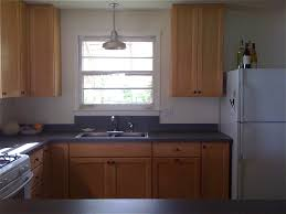over the sink lighting. Kitchen Lighting Over Sink Light Cylindrical Brown French Country Bamboo Beige Islands Countertops Backsplash Flooring The