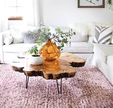 This round coffee table has a fun twist with the blue base and metal braces! Sourcing Materials For A Live Edge Coffee Table A Beautiful Mess