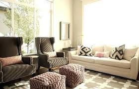 lumbar pillow on sofa chic living room features a white sofa lined with black and white pillows by as well as a pair of brown chairs lined with pink lumbar