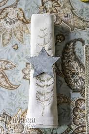 Feather napkin with galvanized metal star napkin ring.