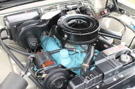 the 1962 pontiac tempest a car half of an engine from