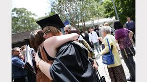 newcastle uni graduation send your photos newcastle herald jessica woodley congratulated by her sister after graduating a psychology degree at newcastle uni