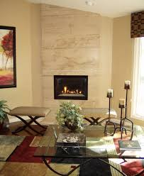 Floor to ceiling travertine fireplace that creates a dramatic focal point.  #Home #Interior
