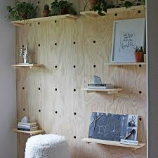 this giant pegboard accent wall is trendy and quite practical for rachel metz of living to diy it s an eye catching accent wall to her office space