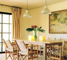 pale yellow dining room. yellow wall paint and candles dining room decorating with light color pale u