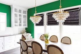 brass bling chandeliers over gray wood dining table