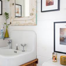 The shelves combine industrial pipes and wood to give the bathroom a farmhouse vibe. Small Bathroom Best Wall Shelves Storage Ideas Apartment Therapy