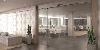 assa abloy sl500 all glass sliding door system with transpa option in hospitality