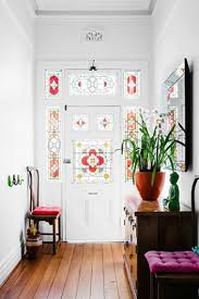 bright sunny entry with modern antique mix of styles and stain glass leadlight window at front