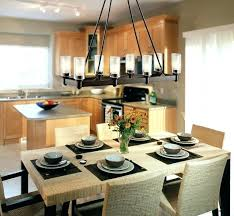 contemporary dining room lighting ideas black iron rectangle dining room chandelier over wicker rattan dining table top and dining chairs also flower