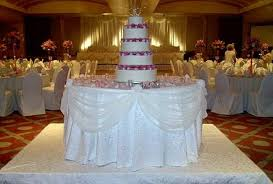swags around the cake table jpg