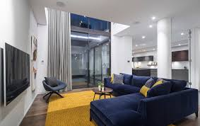 navy and gold living room living room contemporary with yellow area rug blue sofa