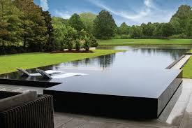 Rectangular infinity pool in modern backyard. APSP. Designer: Selective  Designs