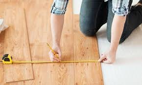 carpet and flooring. man laying laminate carpet and flooring