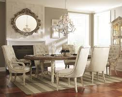 7 Piece Oval Dining Table with Upholstered Arm & Side Chairs by