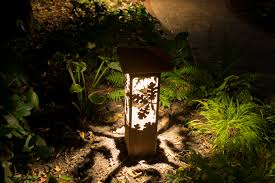 exquisite lighting. a decorative outdoor lighting fixture anchors this cleveland landscape exquisite