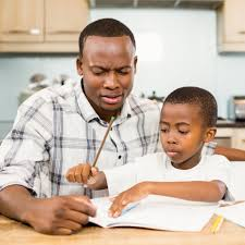 Parents helping their daughter with school homework   Stock Photo