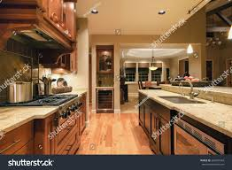 Cabinets With Lights On Top Home Kitchen Island Sink Cabinets Pendant Stock Photo Edit