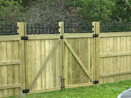 wood picket fence gate. Wood Fence Pictures Double Swing Gate With Iron Lattice Accent Wooden . Picket