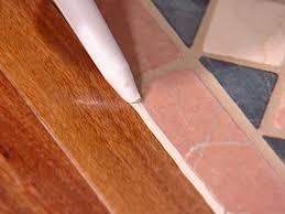 Wood and tile floor designs Wooden Finish Run Small Bead Of Caulk Between Wood And Tile Marmol Export How To Install Mixedmedia Floor Howtos Diy