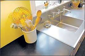 a richlite countertop offers a sharp contrast to a stainless steel sink richlite which