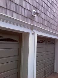 methods of wrapping o head garage door frame