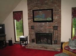 durham ct tv mounted above fireplace on brick looks amazing