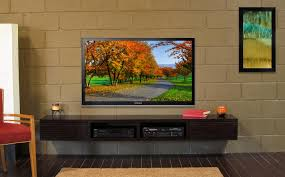 black wooden wall mounted floating tv stand with storage and open shelf hanging on brick media console for inch plus units furniture entertainment center