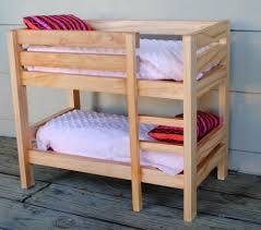 vintage wooden doll bunk bed designed for 18 inch dolls with feminine quilts plus bright striped pillows set