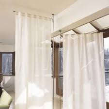 standalone curtain panel holders floor to ceiling tension mount pole holds it in place anywhere from umbra fabric room divider r68 fabric