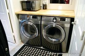 laundry room countertop over washer dryer cottage laundry room with tension drying rod over enclosed washer
