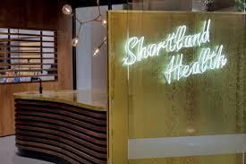 the neon shortland health frontage sign marks a departure from the typical medical