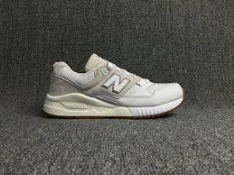 picture of new balance all white leather running shoes